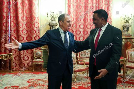 In this photo released by Russian Foreign Ministry Press Service, Russian Foreign Minister Sergey Lavrov, left, welcomes Workneh Gebeyehu, Executive Secretary of The Intergovernmental Authority on Development (IGAD) for their talks in Moscow, Russia