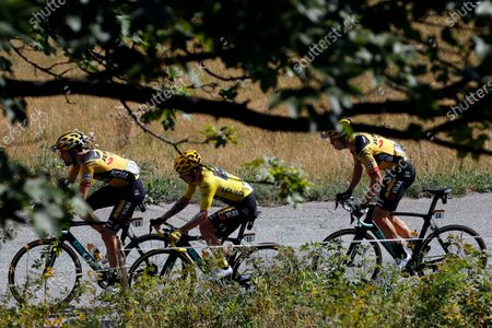 Netherland's Tom Dumoulin, left, Slovenia's Primoz Roglic wearing the overall leader's yellow jersey, center, and Belgium's Wout Van Aert, right, ride with the pack during the stage 17 of the Tour de France cycling race over 170 kilometers (105 miles), with start in Grenoble and finish in Meribel Col de la Loze