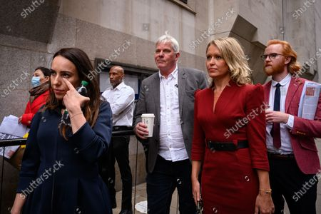 Stock Image of Stella Morris (left), the girlfriend of Julian Assange arrives at court accompanied by Wikileaks editor Kristinn Hrafnsson and and Assange's lawyer Jennifer Robinson, on the first day of Julian Assange's extradition trial at the Old Bailey. The activist and founder of Wikileaks is wanted by the United States authorities in connection with the publication of classified documents in 2010 and 2011.