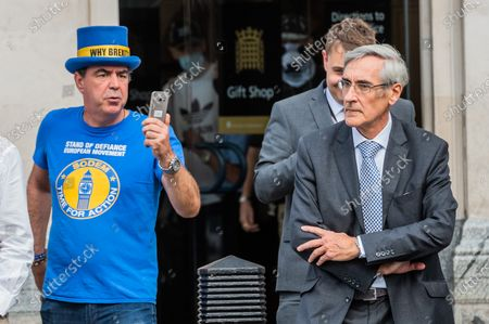 Stock Photo of An angry John Redwood is heckled by pro EU supporters as he makes his way to PMQ's - Protests outside Parliament as the Government pushes through its internal market bill which sets out rules on areas such as mutual recognition to keep trade seamless. But the bill, controversially, also includes power for the government to amend parts of the withdrawal agreement, signed by Boris Johnson and the EU in January, such as over elements connected to preventing a post-Brexit hard border between Northern Ireland and the Republic of Ireland.
