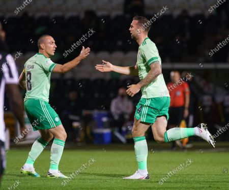 Shane Duffy of Celticis congratulated by Celtic captain Scott Brown as he runs back to the halfway line after scoring with a header to draw level 1-1