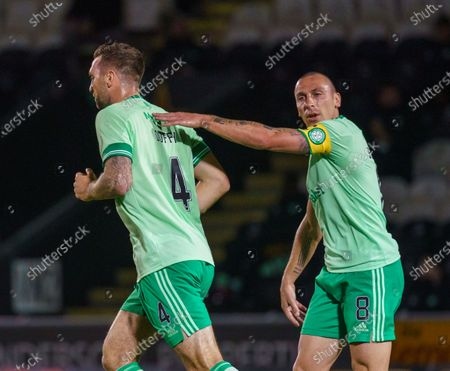 Stock Picture of Shane Duffy of Celticis congratulated by Celtic captain Scott Brown as he runs back to the halfway line after scoring with a header to draw level 1-1