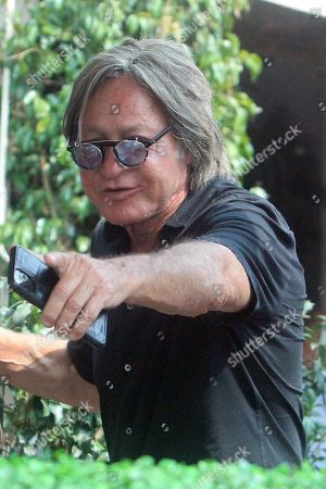 Stock Image of Mohamed Hadid is seen pointing.