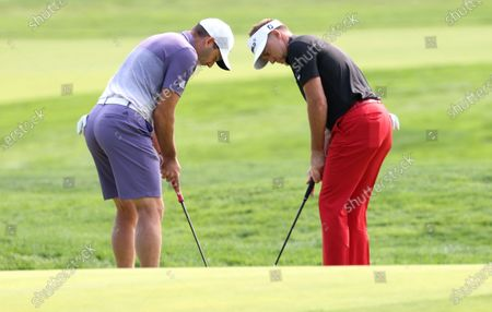 Sergio Garcia of Spain (L) and Ian Poulter of England (R) putt on the twelfth hole during the final practice round for the 2020 US Open at Winged Foot Golf Club in Mamaroneck, New York, USA, 16 September 2020. The 2020 US Open will be played from 17 September through 20 September in front of no fans due to the ongoing coronovirus pandemic.
