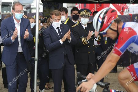 French President Emmanuel Macron (C) and Tour de France director Christian Prudhomme (L) applaud a rider at the Col de la Loze during the stage 17 of the Tour de France cycling race over 170 kilometers, with start in Grenoble and finish in Meribel Col de la Loze, Wednesday, 16 September 2020.