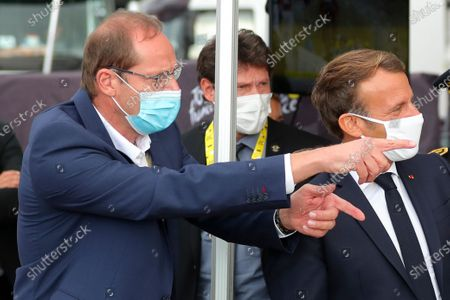 French President Emmanuel Macron, right, listen to Tour de France director Christian Prudhomme at the Col de la Loze during the stage 17 of the Tour de France cycling race over 170 kilometers (105 miles), with start in Grenoble and finish in Meribel Col de la Loze