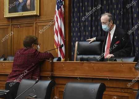 Rep. Karen Bass, D-Calif., left, talks with Committee Chairman Eliot Engel, D-N.Y., before a House Committee on Foreign Affairs hearing looking into the firing of State Department Inspector General Steven Linick, on Capitol Hill in Washington