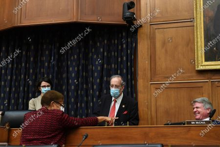 Rep. Karen Bass, D-Calif., left, talks with Committee Chairman Eliot Engel, D-N.Y., center, and Ranking Member Michael McCaul, R-Tex., right, before a House Committee on Foreign Affairs hearing looking into the firing of State Department Inspector General Steven Linick, on Capitol Hill in Washington