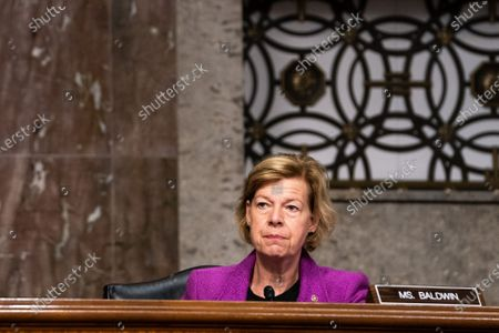 Senator Tammy Baldwin, D-Wis., listens during the Senate Appropriations subcommittee hearing 'Review of Coronavirus Response Efforts', on Capitol Hill in Washington, DC, USA, on 16 September 2020.