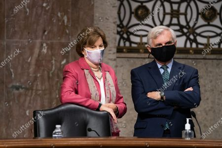 Senators Jeanne Shaheen, D-N.H., left, and Jack Reed, D-R.I., right, speak to each other before a Senate Appropriations subcommittee hearing 'Review of Coronavirus Response Efforts', on Capitol Hill in Washington, DC, USA, on 16 September 2020.