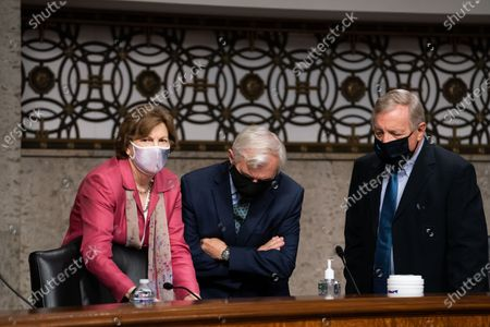Senators Jeanne Shaheen, D-N.H., left, Jack Reed, D-R.I., center, and Dick Durbin, D-Ill. right,speak to each other before a Senate Appropriations subcommittee hearing 'Review of Coronavirus Response Efforts', on Capitol Hill in Washington, DC, USA, on 16 September 2020.