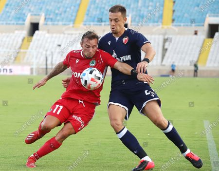Eric Bautheac (L) of Omonia in action against Milan Rodic (R) of Red Star Belgrade during the UEFA Champions League third round qualification match between Omonia Nicosia vs Red Star Belgrade at the GSP stadium in Nicosia, Cyprus, 16 September 2020.