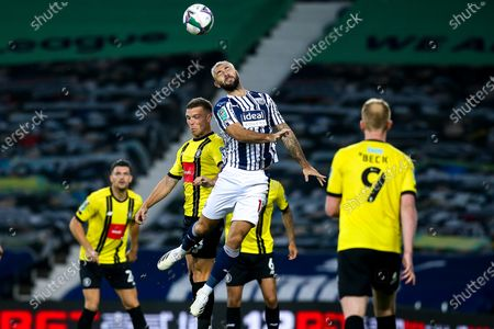 Charlie Austin of West Bromwich Albion heads the ball