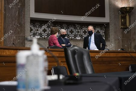 Sen. Jeanne Shaheen, D-N.H., Sen. Jack Reed, D-R.I., and Sen. Dick Durbin, D-Ill., talk at a hearing with the Senate Appropriations Subcommittee on Labor, Health and Human Services, Education, and Related Agencies, on Capitol Hill in Washington