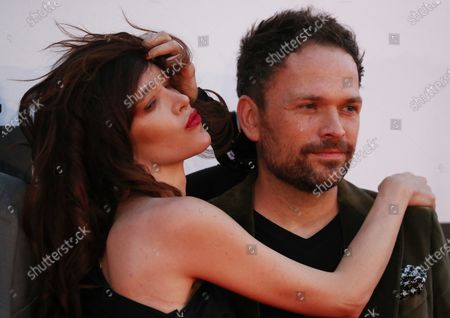 Stock Photo of Paz de la Huerta (L) and Canadian director Michael Maxxis (R) on the red carpet of the opening of the 27th Oldenburg International Film Festival (Filmfest Oldenburg) in Oldenburg, northern Germany, 16 September 2020. The festival opens with the movie Puppy Love' by director Michael Maxxis.