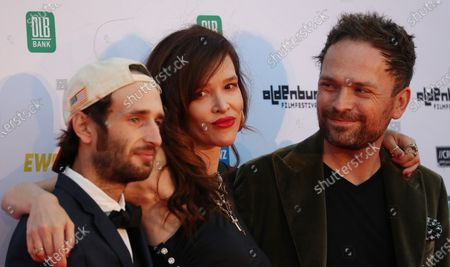 Stock Picture of Hopper Penn, US actress Paz de la Huerta and Canadian director Michael Maxxis on the red carpet of the opening of the 27th Oldenburg International Film Festival (Filmfest Oldenburg) in Oldenburg, northern Germany, 16 September 2020. The festival opens with the movie Puppy Love' by director Michael Maxxis.