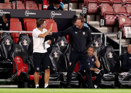 Stock Photo of Brentford's coach Thomas Frank, left, speaks with Southampton's manager Ralph Hasenhuettl before the English League Cup soccer match between Southampton and Brentford at St. Mary's Stadium in Southampton, England