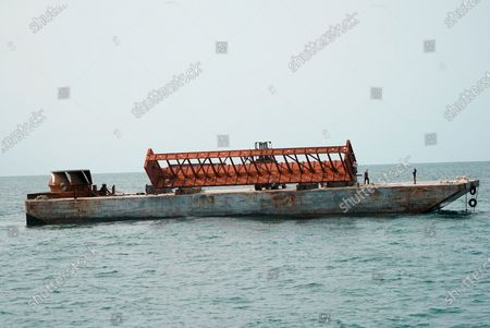 In this photo provided the Office of Governor Andrew M. Cuomo, an old rail car is dumped into the ocean a few miles off shore from Point Lookout, N.Y., . The debris will be used to create an artificial reef that will attract fish and other marine life