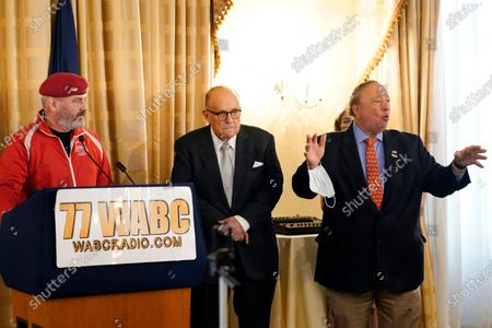 Nwe York City 2021 mayoral candidate Curtis Sliwa, left, and former New York Mayor Rudy Giuliani, center, listen as businessman John Catsimatidis, right, speaks during a press conference at the Women's Republican Club, in New York. Catsimatidis is mulling a run for mayor as a Republican in 2021 race. Catsimatidis, a businessman, is the Gristedes supermarket chain owner
