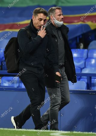 Tv pundits Gary Neville (L) and Jamie Carragher, former players Manchester United and Liverpool respectively, leave the stadium after the English Carabao Cup second round match between Everton and Salford City in Liverpool, Britain, 16 September 2020. Everton won 3-0.
