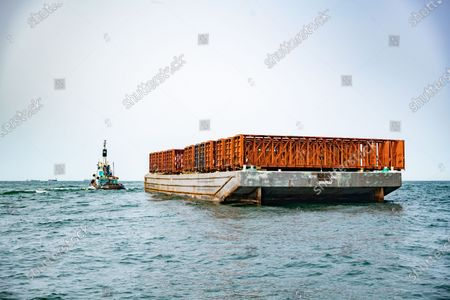 A barge carrying materials for an artifical reef off the south shore of Long Island, New York, USA, on 16 September 2020. New York Governor Andrew M. Cuomo held a press conference about funding for artifical reefs on a boat off the south shore of Long Island.