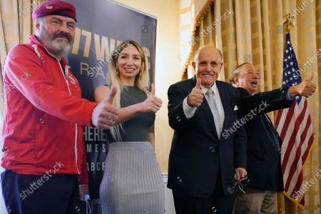 From left, Guardian Angels founder and New York Republican mayoral candidate Curtis Sliwa, Manhattan GOP chairwoman Andrea Catsimatidis, former New York Mayor Rudy Giuliani and businessman John Catsimatidis pose for a group photograph during a press conference at the Women's Republican Club, in New York. The event was billed an an opportunity to present a plan to address a historic spike in shootings and homicide, as well as the city's homelessness and housing crises in New York city