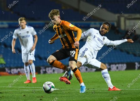 Leeds United's Tyler Roberts, right, stops with foul Leeds United's James Scott, left, during the English League Cup soccer match between Leeds United and Hull in Leeds, England