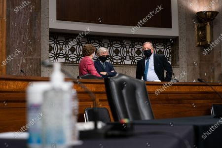 """United States Senator Jeanne Shaheen (Democrat of New Hampshire), left, US Senator Jack Reed (Democrat of Rhode Island) center, and US Senator Dick Durbin (Democrat of Illinois) right, speak to each other before a hearing with the US Senate Committee on Appropriations Subcommittee on Labor, Health and Human Services, Education, and Related Agencies """"Hearing to Review Coronavirus Response Efforts"""" in Washington, DC on Wednesday, September 16, 2020."""