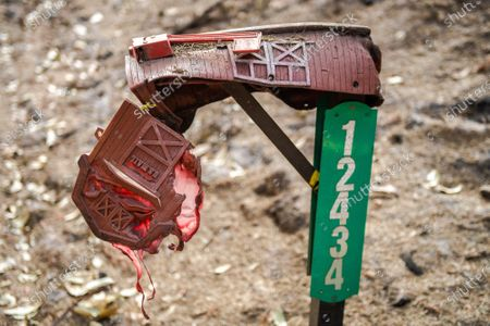 Stock Picture of A general view of a melted mailbox on Alba Road after the CZU Lightning Complex fire tore through parts of Felton in Santa Cruz County, California, U.S., on Thursday, Aug. 20, 2020. Since the beginning of the year, wildfires have burned over 3.2 million acres in California. Since August 15, when California's fire activity elevated, there have been 25 fatalities and over 4,200 structures destroyed.