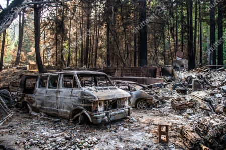 A general view burned out vehicles on Alba Road after the CZU Lightning Complex fire tore through parts of Felton in Santa Cruz County, California, U.S., on Thursday, Aug. 20, 2020. Since the beginning of the year, wildfires have burned over 3.2 million acres in California. Since August 15, when California's fire activity elevated, there have been 25 fatalities and over 4,200 structures destroyed.