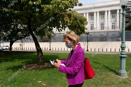 Sen. Tammy Baldwin, D-Wis., walks to the U.S. Capitol, in Washington