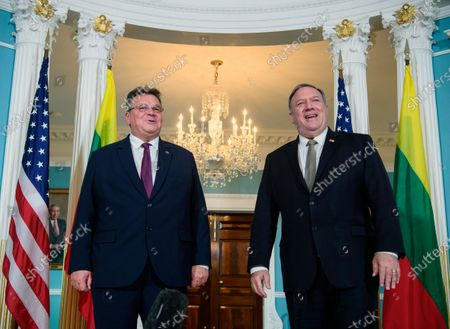 Stock Photo of Secretary of State Mike Pompeo, right, and Lithuanian Foreign Minister Linas Linkevicius, pose during a photo opportunity at the State Department, in Washington