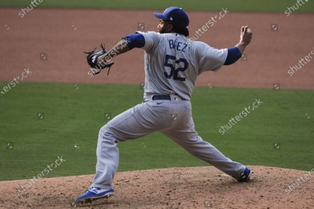 Los Angeles Dodgers reliever Pedro Baez pitches to a San Diego Padres batter during the ninth inning of a baseball game, in San Diego