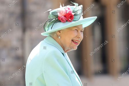 """Britain's Queen Elizabeth smiles after awarding Captain Sir Thomas Moore his knighthood during a ceremony at Windsor Castle in Windsor, England. The former British colony of Barbador, once known as """"Little England,"""" announced Tuesday, Sept. 15, that it plans to replace the monarch with its own head of state in time for next year's 55th independence anniversary"""