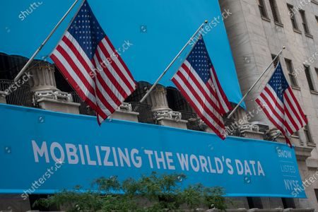 A banner announcing the IPO of Snowflake, a data storage provider, hangs outside the New York Stock Exchange (NYSE) on Wall Street