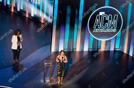 Stock Photo of Maren Morris accepts the female artist of the year award as presenter CeCe Winans, left, looks on during the 55th annual Academy of Country Music Awards at the Grand Ole Opry House, in Nashville, Tenn
