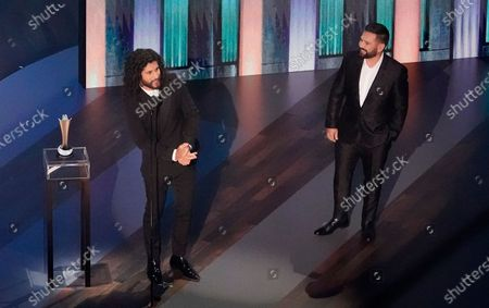 Dan Smyers, left, and Shay Mooney, of Dan + Shay, accept the duo of the year award during the 55th annual Academy of Country Music Awards at the Grand Ole Opry House, in Nashville, Tenn
