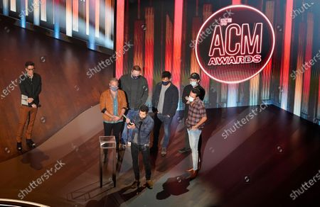 "Stock Image of Old Dominion accepts the song of the year award for ""One Man Band"" as presenter Bobby Bones, left, looks on during the 55th annual Academy of Country Music Awards at the Grand Ole Opry House, in Nashville, Tenn"