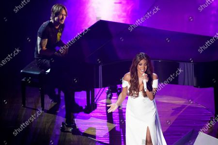 """Stock Picture of Mickey Guyton, right, and Keith Urban perform """"What Are You Gonna Tell Her?"""" during the 55th annual Academy of Country Music Awards at the Grand Ole Opry House, in Nashville, Tenn"""