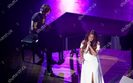 """Stock Photo of Mickey Guyton, right, and Keith Urban perform """"What Are You Gonna Tell Her?"""" during the 55th annual Academy of Country Music Awards at the Grand Ole Opry House, in Nashville, Tenn"""