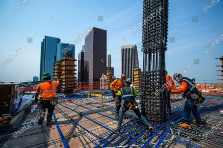 Iron workers set columns made out of rebar, while working on the residential tower under construction at The Grand, a $1 billion high-rise mixed use complex on Bunker Hill located across the street from the Walt Disney Concert Hall. The residential tower will be 39 floors high when completed. (Mel Melcon / Los Angeles Times)