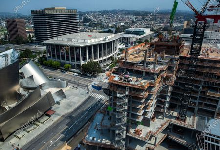 Construction continues on the Hotel Tower at The Grand, a $1 billion high-rise mixed use complex on Bunker Hill in downtown Los Angeles. At lower left is the Walt Disney Concert Hall and middle, left is the Music Center. The hotel tower will be 20 stories high when finished. (Mel Melcon / Los Angeles Times)