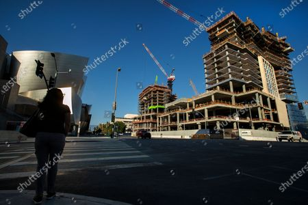Overall, shows The Grand, a $1 billion high-rise mixed use complex on Bunker Hill in downtown Los Angeles, located across the street from the Walt Disney Concert Hall, left, as seen from Grand Ave and 2nd St. At center, background, is the hotel tower that will be 20 stories high when finished, and at right is the residential tower that will be 39 floors high when finished. (Mel Melcon / Los Angeles Times)