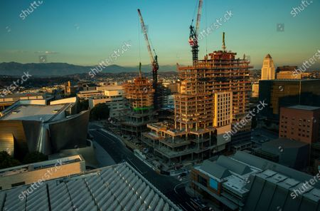 Overall, shows The Grand, a $1 billion high-rise mixed use complex on Bunker Hill in downtown Los Angeles located across the street from the Walt Disney Concert Hall, seen at left. In background, center is the hotel tower that will be 20 stories high when finished, and at right is the residential tower that will be 39 floors high when finished. (Mel Melcon / Los Angeles Times)