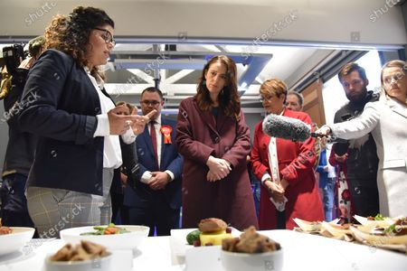 New Zealand Prime Minister Jacinda Ardern (C) inspects products at at FoodHQ Science Park during campaigning in Palmerston North, New Zealand, 17 September 2020. New Zealand will hold its general elections on 17 October 2020.