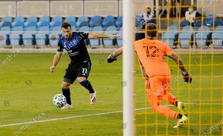 San Jose Earthquakes midfielder Valeri Kazaishvili (11) sets up to shoot against Portland Timbers goalkeeper Steve Clark