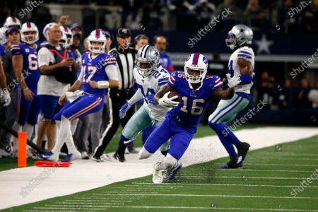 Buffalo Bills wide receiver Robert Foster (16) gains yardage after a catch as Dallas Cowboys cornerback Chidobe Awuzie (24) defends during an NFL football game in Arlington, Texas