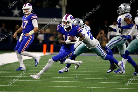 Buffalo Bills wide receiver Robert Foster (16) gains yardage after a catch during an NFL football game against the Dallas Cowboys in Arlington, Texas