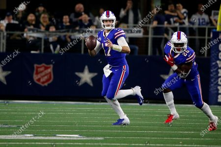 Buffalo Bills quarterback Josh Allen (17) scrambles as he's followed by running back Devin Singletary (26) during an NFL football game against the Dallas Cowboys in Arlington, Texas