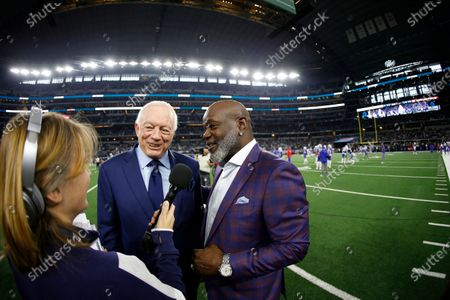 Stock Image of Dallas Cowboys radio broadcast reporter Kristi Scales, left, interviews team owner Jerry Jones, center, and former player Emmitt Smith, right, before an NFL football game against the Buffalo Bills in Arlington, Texas